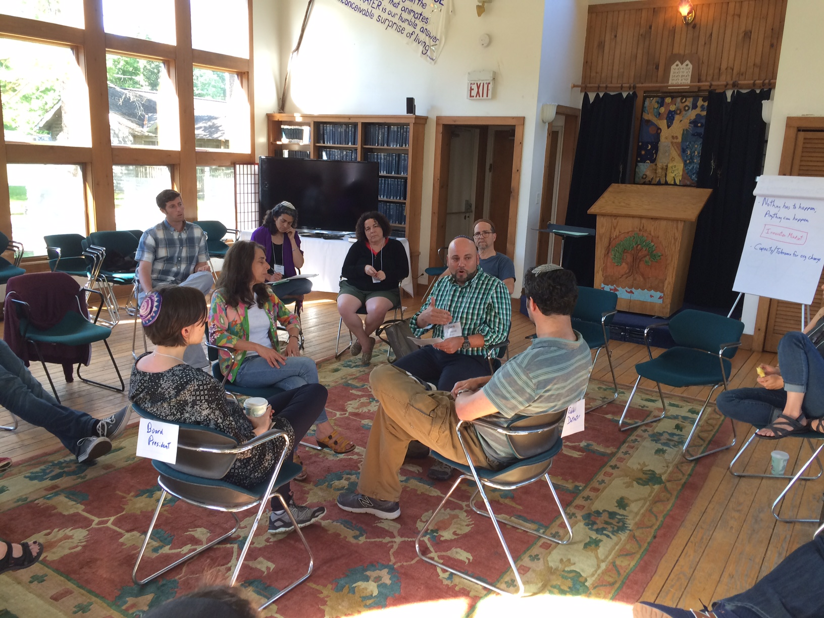 CLI fellows having a discussion while seated in a circle